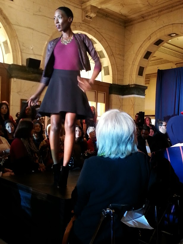 Philadelphia Fashion Incubator model wearing a skater skirt with a burgundy top topped off with cropped textured blazer. Photo Credit: Bianca Dorville